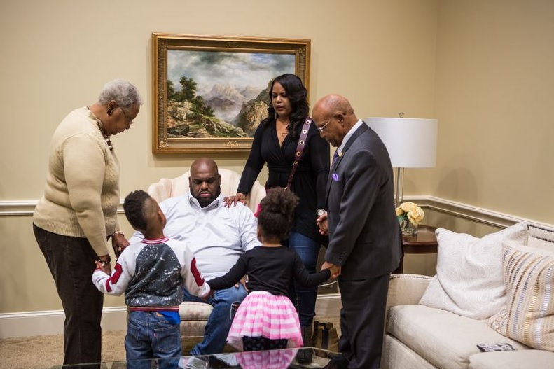 Pastor John Gray with his family. (Photo credit: OWN: Oprah Winfrey Network)