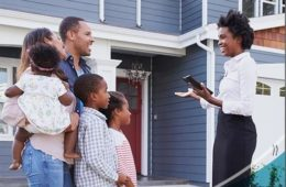 black family and black real estate agent outside of house1