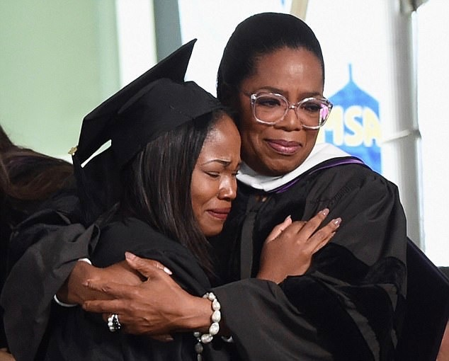 Oprah hugs a senior at Agnes Scott who graduated from the Oprah Winfrey Leadership Academy for Girls in South Africa Read more: http://www.dailymail.co.uk/news/article-4503742/Oprah-Winfrey-gives-wisdom-filled-commencement-address.html#ixzz4hAua8SWG Follow us: @MailOnline on Twitter | DailyMail on Facebook