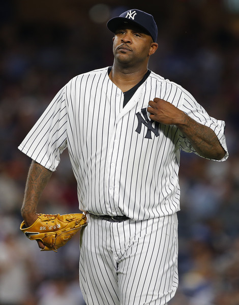 Pitcher CC Sabathia #52 of the New York Yankees walks off the mound after being relieved in the seventh inning against the Los Angeles Dodgers during a game at Yankee Stadium on September 13, 2016 in New York City.