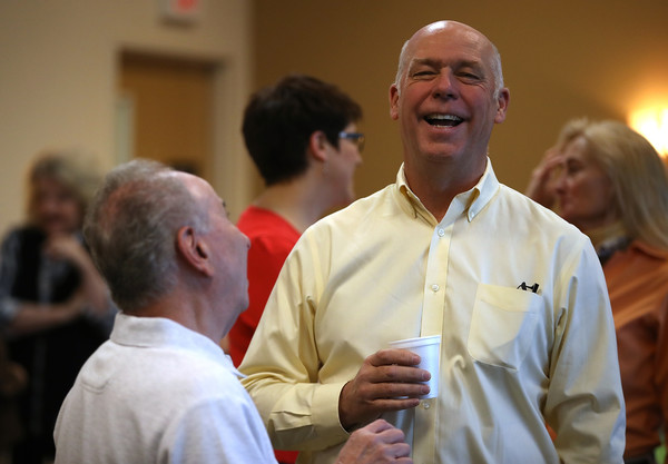 Republican congressional candidate Greg Gianforte talks with a supporter during a campaign meet and greet at Lambros Real Estate on May 24, 2017 in Missoula, Montana.