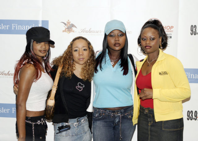 """WASHINGTON - JUNE 7: Members of Xscape pose backstage at the Hip-Hop Summit on Financial Empowerment held at the Washington Convention Center June 7, 2005 in Washington DC. The event, sponsored by Chrysler Financial, the Hip-Hop Summit Action Network, Anheuser-Bush and Orman, is designed to raise awareness among young adults age 18-35 under the theme """"Get Your Money Right."""" (Photo by Shaun Heasley/Getty Images)"""