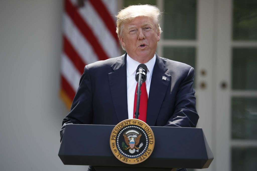 US President Donald Trump announces his decision that the United States will withdraw from the landmark Paris Climate Agreement, in the Rose Garden of the White House in Washington.
