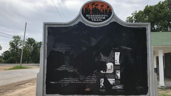 The Emmett Till historical sign has been scraped almost completely of text and photographs. It was erected in 2011, the first on the Mississippi Freedom Trail. (Photo: Courtesy of Cultural Leadership)