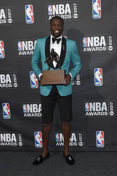 NBA player Draymond Green poses with Kia NBA Defensive Player of the Year award at the 2017 NBA Awards live on TNT on June 26, 2017 in New York, New York.