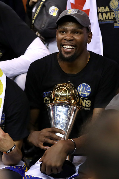 Kevin Durant #35 of the Golden State Warriors celebrates with the Bill Russell NBA Finals Most Valuable Player Award after defeating the Cleveland Cavaliers 129-120 in Game 5 to win the 2017 NBA Finals at ORACLE Arena on June 12, 2017 in Oakland, California.