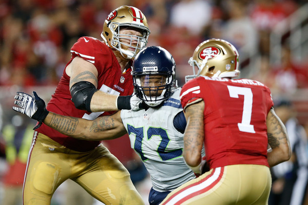 Michael Bennett #72 of the Seattle Seahawks sacks Colin Kaepernick #7 of the San Francisco 49ers during their NFL game at Levi's Stadium on October 22, 2015 in Santa Clara, California.