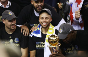 Stephen Curry #30 of the Golden State Warriors celebrates after defeating the Cleveland Cavaliers 129-120 in Game 5 to win the 2017 NBA Finals at ORACLE Arena on June 12, 2017 in Oakland, California.