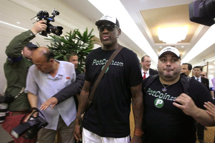 Former NBA basketball star Dennis Rodman, center, arrives at Sunan International Airport on Tuesday, June 13, 2017, in Pyongyang, North Korea. Rodman has arrived in North Korea on his first visit since President Donald Trump took office. (AP Photo/Kim Kwang Hyon)