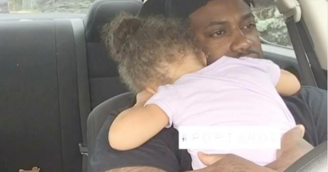 father hugs toddler daughter