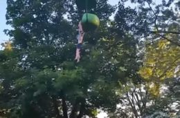 girl hanging from six flags ride