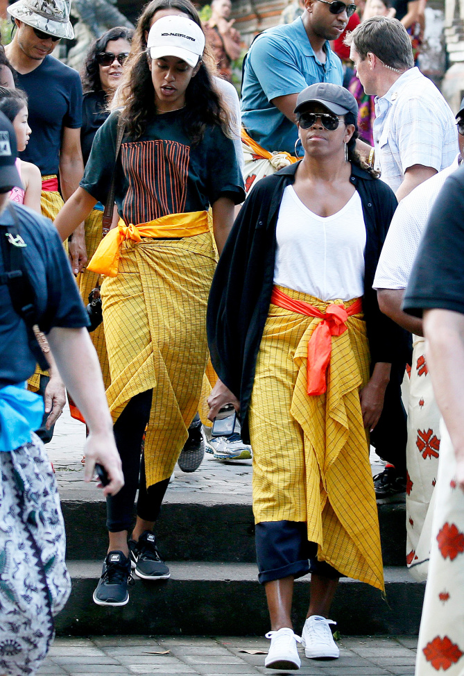Former US First Lady Michelle Obama (R) and her daughter Malia Obama (L) visit the Tirta Empul Temple during a family holiday in Bali, Indonesia, 27 June 2017. EPA/MADE NAGI EPA