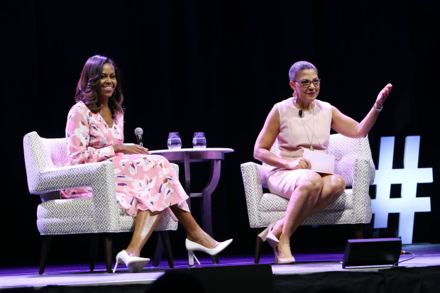Former First Lady Michelle Obama speaks, emphasizing that women must celebrate their strength, during a live conversation with The Women's Foundation of Colorado President and CEO Lauren Y. Casteel at Pepsi Center on July 25, 2017 in Denver.