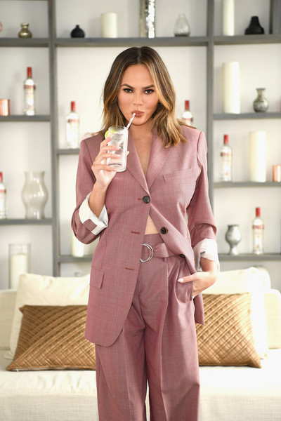 """Chrissy Teigen hosts a """"Cocktails with Chrissy"""" event featuring delicious Smirnoff No. 21 vodka summer cocktails on April 27, 2017 in New York City."""
