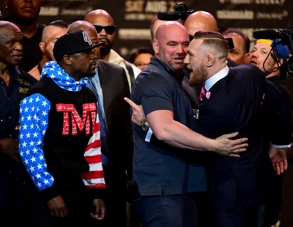 Dana White, .President of the Ultimate Fighting Championship comes between Floyd Mayweather Jr. and Conor McGregor Floyd during the White Mayweather Jr. v Conor McGregor World Press Tour at Staples Center on July 11, 2017 in Los Angeles, California.