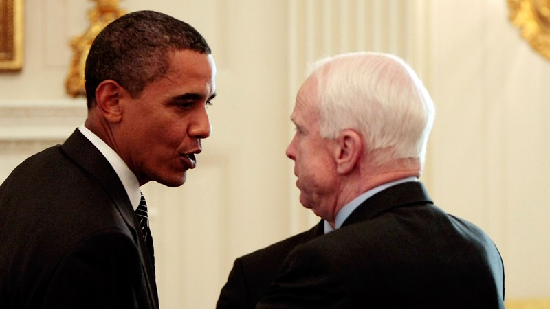 WASHINGTON - JUNE 25: U.S. President Barack Obama (L) talks with Sen. John McCain (R-AZ) after a meeting with a bipartisan group of Senators and members of Congress in the State Dining Room at the White House June 25, 2009. (Photo by Chip Somodevilla/Getty Images)