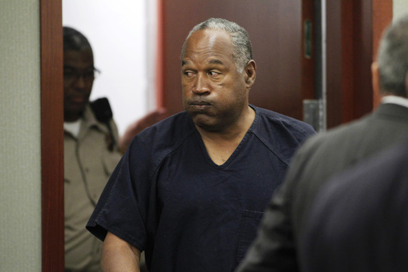 O.J. Simpson returns to the courtroom after a lunch break during the fifth day of an evidentiary hearing in Clark County District Court on May 17, 2013 in Las Vegas, Nevada.