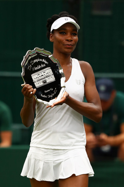Runner-up Venus Williams of The United States poses with her trophy after the Ladies Singles final against Garbine Muguruza of Spain on day twelve of the Wimbledon Lawn Tennis Championships at the All England Lawn Tennis and Croquet Club at Wimbledon on July 15, 2017 in London, England.