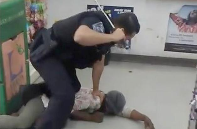 dekalb county cop beating homeless woman