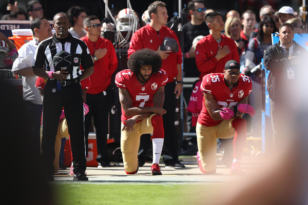 Eric Reid #35 and Colin Kaepernick #7 of the San Francisco 49ers kneel in protest during the national anthem prior to their NFL game against the Tampa Bay Buccaneers at Levi's Stadium on October 23, 2016 in Santa Clara, California.