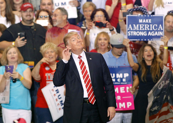 U.S. President Donald Trump gestures during a rally at the Phoenix Convention Center on August 22, 2017 in Phoenix, Arizona.