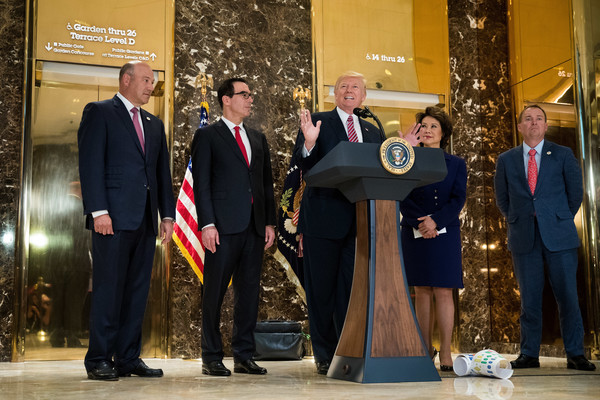 President Donald Trump delivers remarks following a meeting on infrastructure at Trump Tower, August 15, 2017 in New York City. Standing alongside him from L to R, Director of the National Economic Council Gary Cohn, Treasury Secretary Steve Mnuchin, Transportation Secretary Elaine Chao and Director of the Office of Management and Budget Mick Mulvaney.