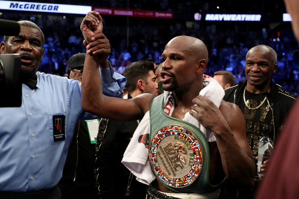 Floyd Mayweather Jr. celebrates with the WBC Money Belt after his TKO of Conor McGregor in their super welterweight boxing match on August 26, 2017 at T-Mobile Arena in Las Vegas, Nevada.