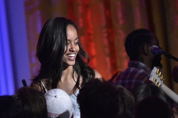 "Malia Obama, daughter of US President Barack Obama, makes her way off the stage after her father sang ""Happy Birthday"" for her during an Independence Day Celebration for military members and administration staff on July 4, 2016 in the East Room of the White House in Washington, DC."