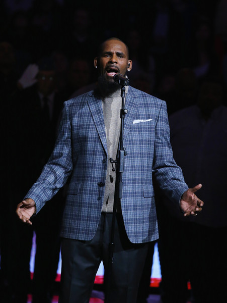 Singer R. Kelly sings the National anthem before the Brooklyn Nets vs the Atlanta Hawks at The Barclays Center on November 17, 2015 in New York City.