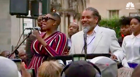 Democratic strategist and political commentator Symone Sanders (L) at the Kaepernick rally (Aug. 23, 2017 - New York City)