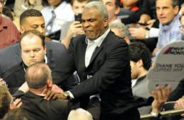 charles oakley with hands on man in madison sq garden