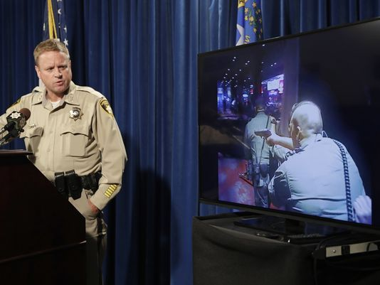 Las Vegas police Undersheriff Kevin McMahill watches body camera footage during a press conference on accusations by Seattle Seahawks player Michael Bennett. (Photo: John Locher, AP)