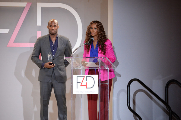 Chris Collins and Iman speak onstage during Fashion 4 Development's 7th Annual First Ladies Luncheon at The Pierre Hotel on September 19, 2017 in New York City.