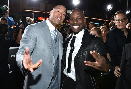 "Dwayne Johnson, left, and Tyrese Gibson arrive at the premiere of ""Furious 7"" at the TCL Chinese Theatre IMAX on Wednesday, April 1, 2015, in Los Angeles. (Photo by John Shearer/Invision/AP)"