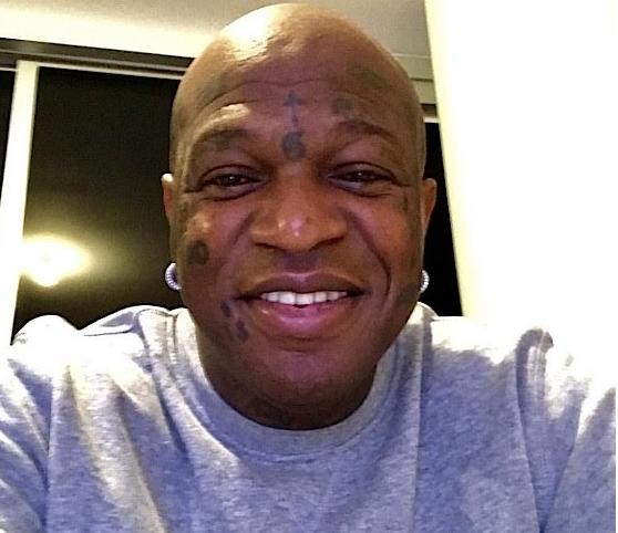 birdman showing TEETH - not grill
