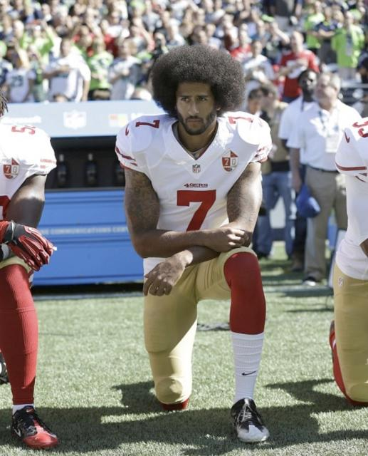 colin kaepernick 2 other players kneeling
