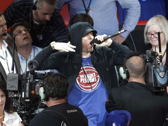 Eminem yells to the crowd before the start of an NBA basketball game between the Detroit Pistons and the Charlotte Hornets, Wednesday, Oct. 18,2017, in Detroit. (Photo: AP)