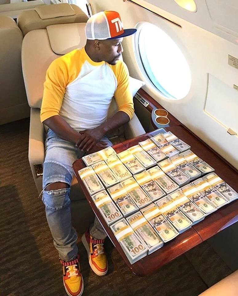 floyd mayweather looking out plane window