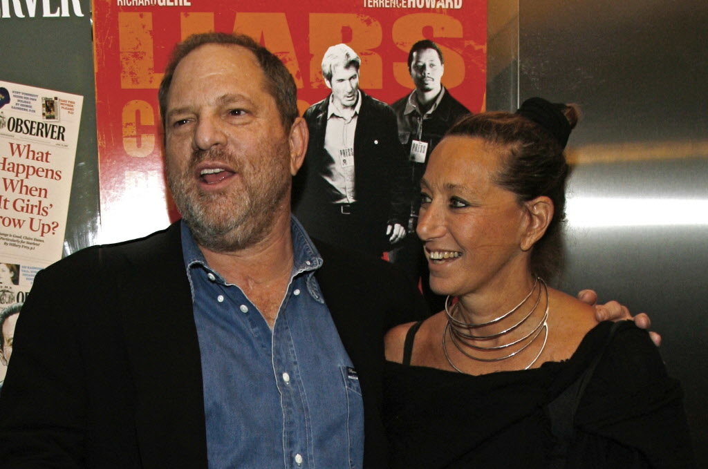 """Harvey Weinstein and Donna Karan arrive at the premiere of """"The Hunting Party"""" at the Paris Theater in New York. Karan apologized on Monday, Oct. 10, 2017, after offering praise for Weinstein the night before following his firing from his company amid allegations of sexual harassment lasting decades."""