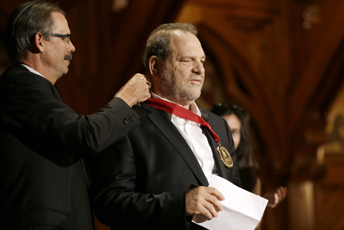 Harvey Weinstein, right, is presented with the W.E.B. Du Bois Medal by Glenn Hutchins during ceremonies Tuesday, Sept. 30, 2014, on the campus of Harvard University. Photo Via AP