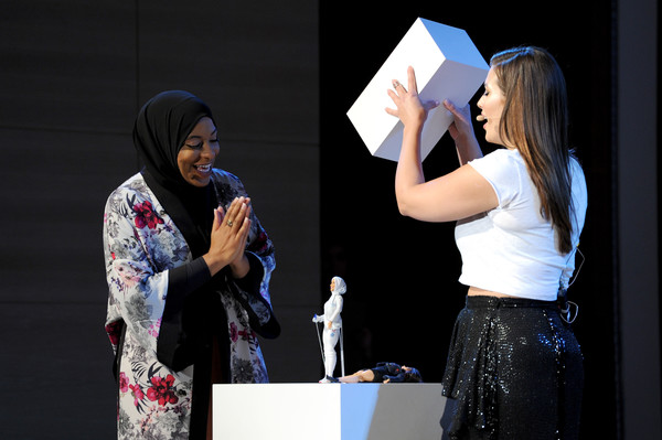 U.S. Olympic Medalist Ibtihaj Muhammad (L) and model/host Ashley Graham reveal the Ibtihaj Muhammad Barbie doll during Glamour Celebrates 2017 Women Of The Year Live Summit at Brooklyn Museum on November 13, 2017 in New York City.