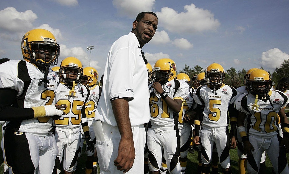 Luther Campbell and his Liberty City Warriors youth football team