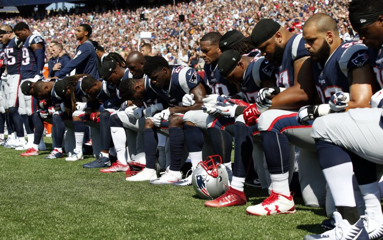 Several New England Patriots players kneel during the national anthem before an NFL football game against the Houston Texans Sunday Sept. 24 2017 in Foxborough Mass