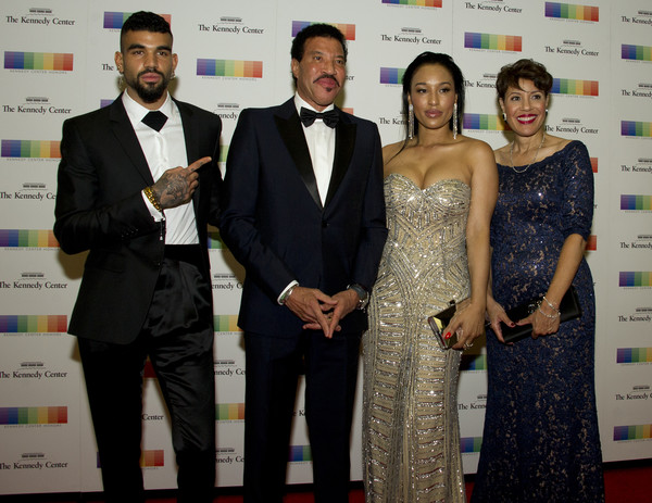 Lionel Richie, second left, arrives with son Miles, left, and girlfriend Lisa Parigi, second right, and sister Deborah Richie, right, for the formal Artist's Dinner honoring the recipients of the 40th Annual Kennedy Center Honors hosted by United States Secretary of State Rex Tillerson at the US Department of State on December 2, 2017 in Washington, DC.