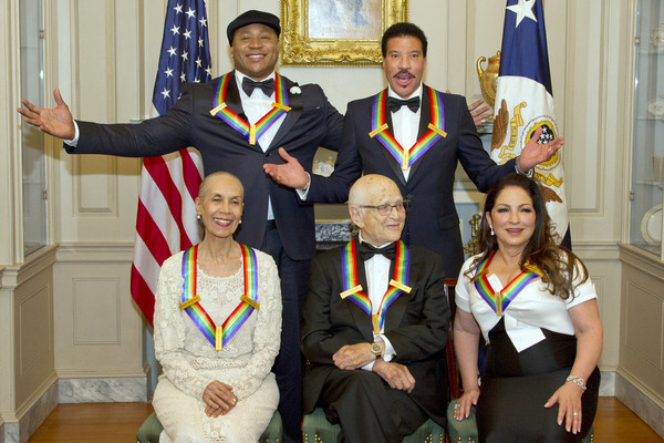 The five recipients of the 40th Annual Kennedy Center Honors pose for a group photo following a dinner hosted by United States Secretary of State Rex Tillerson in their honor at the US Department of State on December 2, 2017 in Washington, D.C.