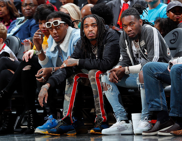 Rappers Takeoff, Quavo and Offset of Migos look on during the game between the Atlanta Hawks and Dallas Mavericks at Philips Arena on December 23, 2017 in Atlanta, Georgia.
