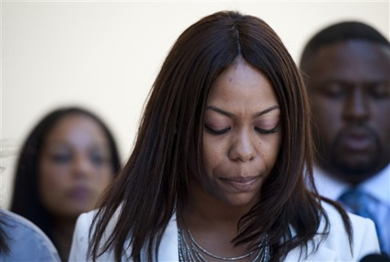 One of Rodney King's daughters, Laura Dene King, speaks to reporters before the public memorial service for her father at Forest Lawn-Hollywood Hills in Los Angeles on Saturday, June 30, 2012.  (AP Photo/Grant Hindsley)