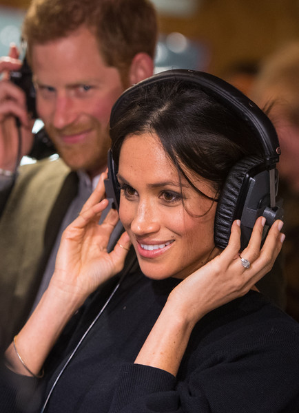 Prince Harry and Meghan Markle listen to a broadcast through headphones at Reprezent 107.3FM in Pop Brixton on January 9, 2018 in London, England.