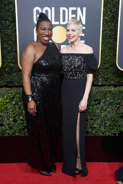 Tarana Burke and Michelle Williams attends The 75th Annual Golden Globe Awards at The Beverly Hilton Hotel on January 7, 2018 in Beverly Hills, California.
