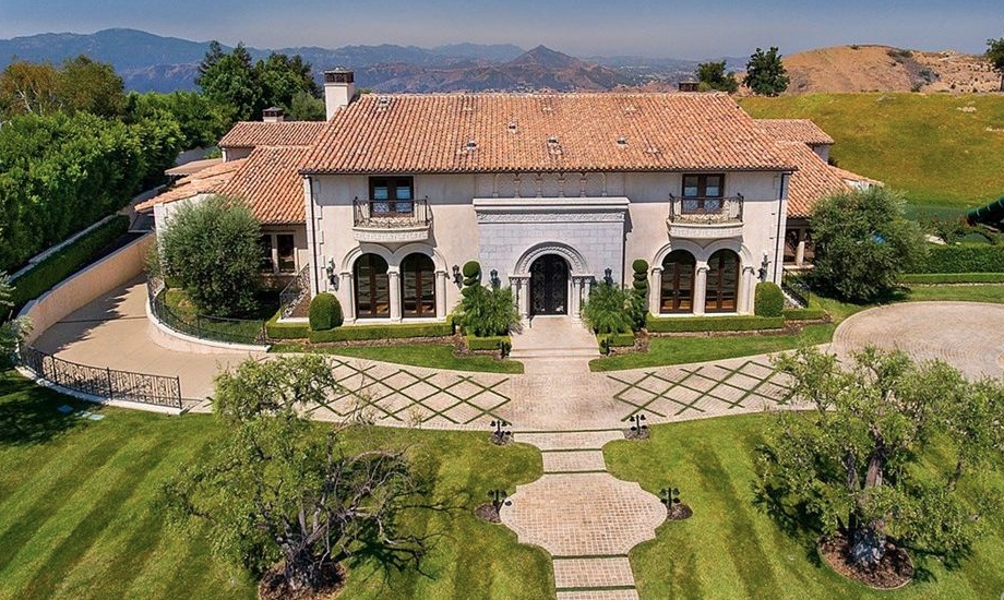 This Mediterranean style mansion owned by Vincent Herbert and Tamar Braxton is located at 25400 Prado De La Felicidad in Calabasas, California and is situated on 2 acres of land.